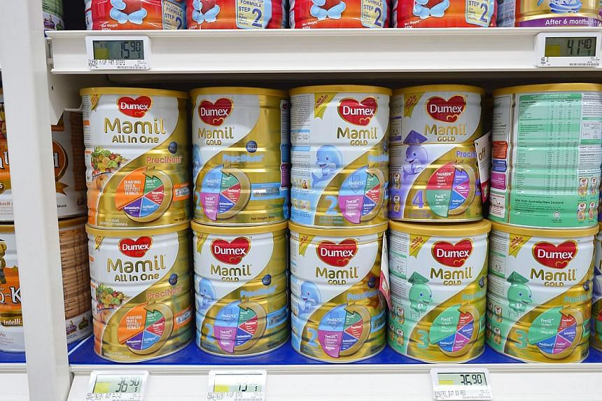 Dumex Mamil Gold 2 900g tins on display for sale at NTUC Fairprice at Jem on Aug 5, 2013. Danone Dumex has recalled more milk formula products in Singapore as a precautionary measure to ensure consumer safety. -- ST PHOTO: ASHLEIGH SIM