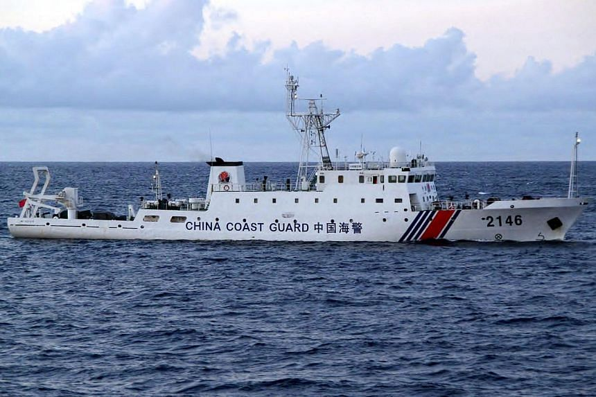 This handout picture taken and released by the Japan Coast Guard on Aug 8, 2013 shows a Chinese Coast Guard ship cruising near the disputed islets known as the Senkaku islands in Japan and Diaoyu islands in China, in the East China Sea. Tokyo said on