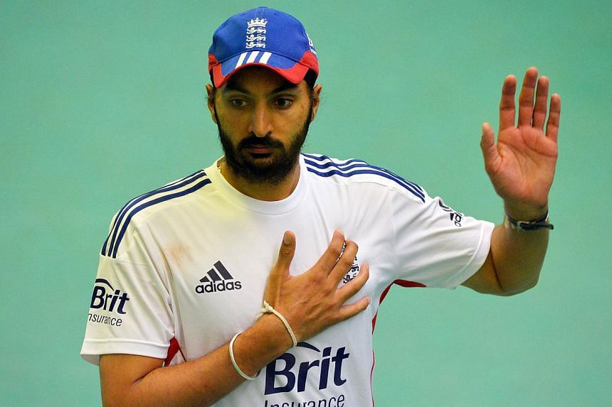 England cricketer Monty Panesar takes part in a training session ahead of the third Ashes cricket Test match between England and Australia at Old Trafford in Manchester, north-west England on Wednesday, July 31, 2013. Panesar has been fined for urina