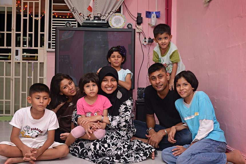 Madam Rokiya with her husband Mohamad Rafi and their six children (from left) Mohamad Raihan, Raihanah Maisarah, Raihanah Masturah, Raihanah Mahirah, Mohamad Rafiqi and Raihanah Maisurah. -- ST PHOTO: NURIA LING