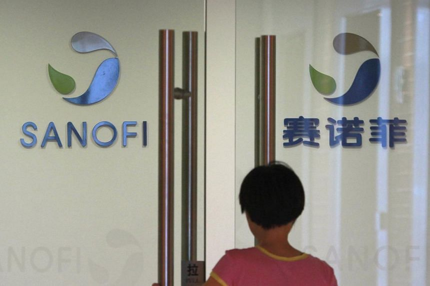 An employee walks into an office of French drugmaker Sanofi in Shanghai on Aug 2, 2013. Chinese authorities visited a Sanofi regional office in Shenyang this week in the latest sign of a widening investigation into Western drugmakers. -- FILE PHOTO: