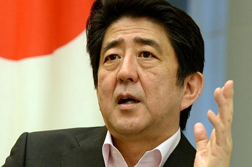 In this photo taken on June 6, 2013, Japanese Prime Minister Shinzo Abe answers a question during an exclusive interview with Agence France-Presse at his official residence in Tokyo. Japanese Prime Minister Shinzo Abe will set up a panel to study the