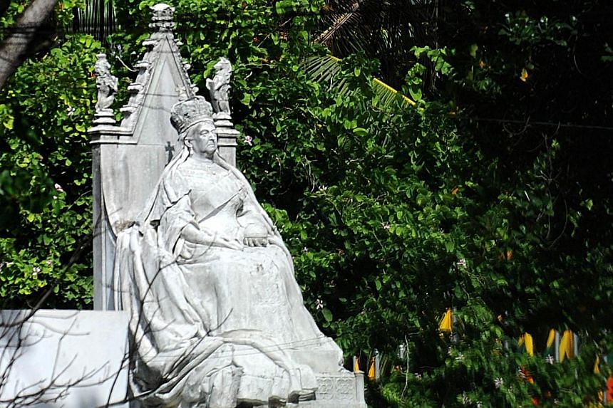 A statue of Britain's Queen Victoria stands at The Colombo Museum in Colombo on Thursday, Aug 8, 2013. A statue of Queen Victoria which was banished from Sri Lanka's presidential palace amid fears that it brought bad luck will now be spruced up for a