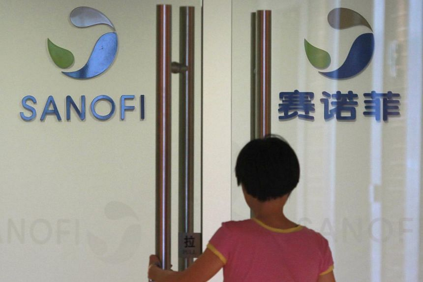 An employee walks into an office of French drugmaker Sanofi in Shanghai on August 2, 2013. Chinese authorities visited a Sanofi regional office in Shenyang this week in the latest sign of a widening investigation into Western drugmakers. -- PHOTO: RE