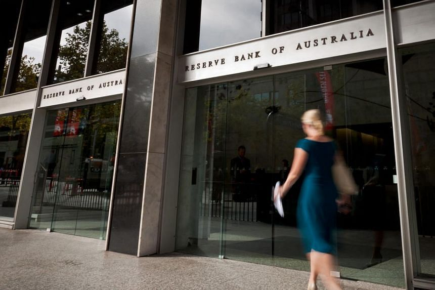 A woman walking past the Reserve Bank of Australia.The Reserve Bank of Australia said it now expected the resources-driven economy to expand 2.25 per cent in the year to December 31 and 2.5 per cent in the 12 months to June 30, 2014. -- FILE PH