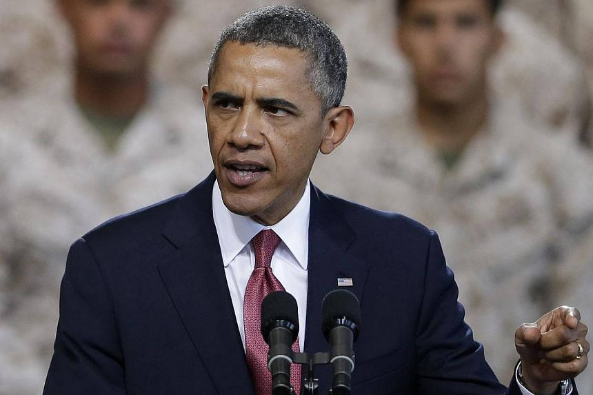 President Barack Obama speaks in front of the Marines on Aug 7, 2013, at Camp Pendleton, California.Mr Obama is to hold a rare White House news conference on Friday, he confirmed on Thursday. -- FILE PHOTO: AP