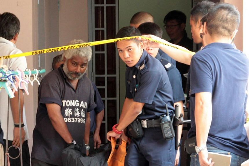 Undertakers and police officers remove the body of the Chinese woman from a flat in Choa Chu Kang on Aug 8, 2013. A Chinese national was charged in court on Friday with the murder of his 41-year-old wife, Madam Liu Bijiao. -- PHOTO: WANBAO