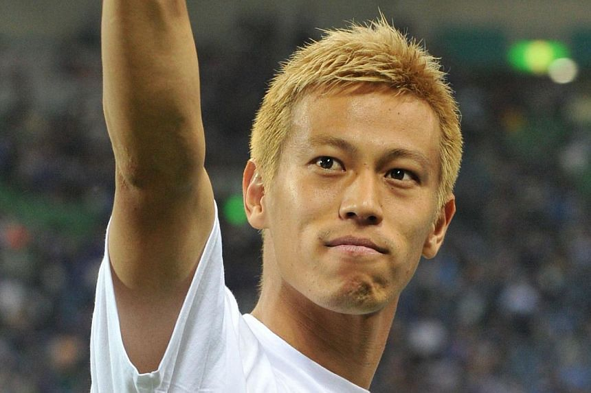 Japan's Keisuke Honda acknowledging to fans after a football match against Australia in the Asian final qualyfying round for the 2014 World Cup in Saitama, suburban Tokyo, on June 4, 2013.Honda says his expected transfer to Italian giants AC Mi