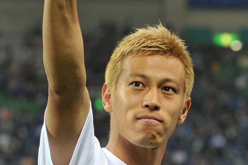 This file photo taken on June 4, 2013, shows Japan's Keisuke Honda acknowledging to fans after a football match against Australia in the Asian final qualifying round for the 2014 World Cup in Saitama. The president of Russian football champions CSKA