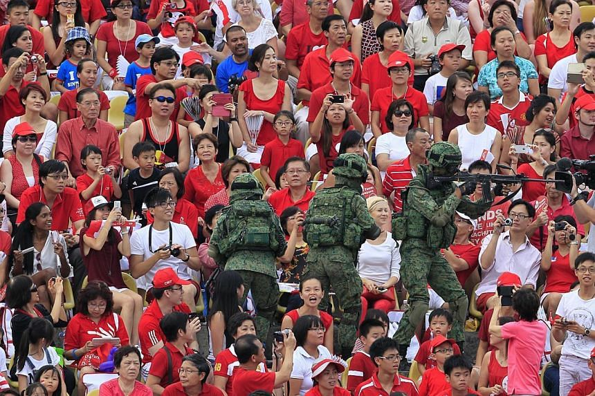 Performers and crowds at the National Day Parade 2013 at the floating platform.--ST PHOTO: KEVIN LIM