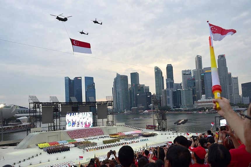 During the three-and-a-half hour National Day Parade on Friday, Aug 9, 2013, 26,000 spectators were treated to a display of defence hardware, aerial flypass, and a variety show with plenty of song and dance.--ST PHOTO:ASHLEIGH SIM