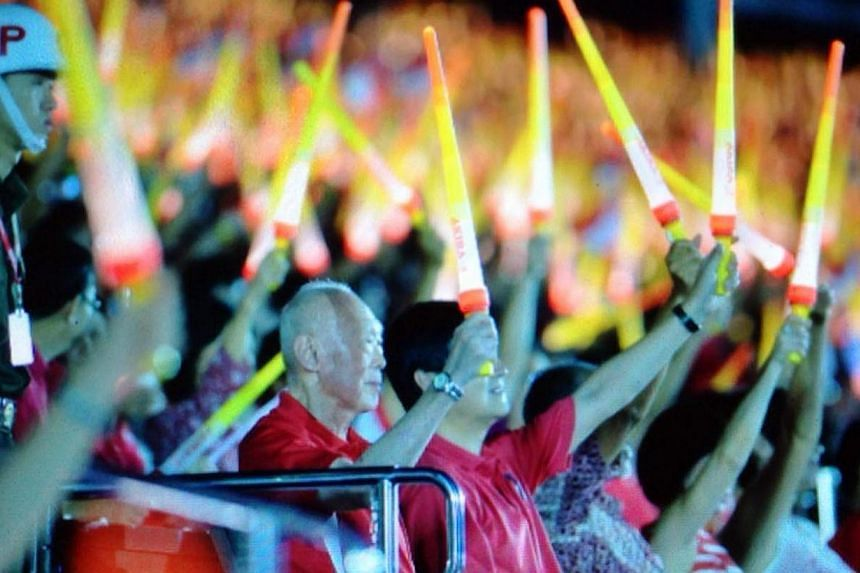Mr Lee Kuan Yew watches the National Day Parade.-- PHOTO: ST PICTURE DESK