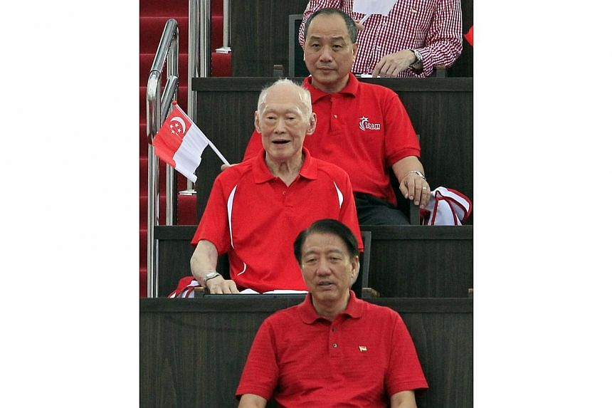 (From top) Aljunied GRC MP Mr Low Thia Khiang, Mr Lee Kuan Yew and DPM Teo Chee Hean at the parade. -- ST PHOTO: KEVIN LIM