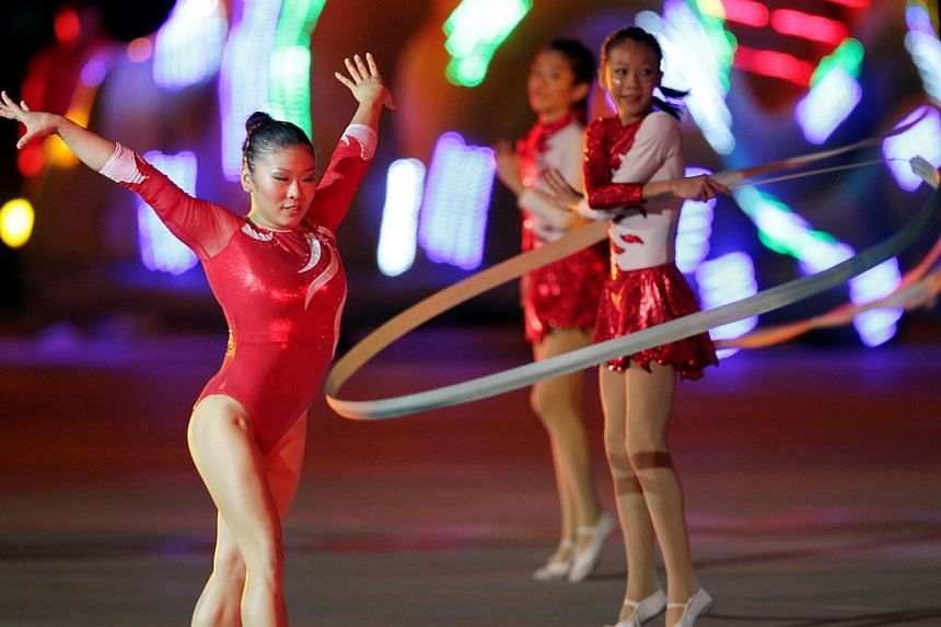 During the three-and-a-half hour National Day Parade on Friday, Aug 9, 2013, 26,000 spectators were treated to a display of defence hardware, aerial flypass, and a variety show with plenty of song and dance.--ST PHOTO:NEO XIAOBIN