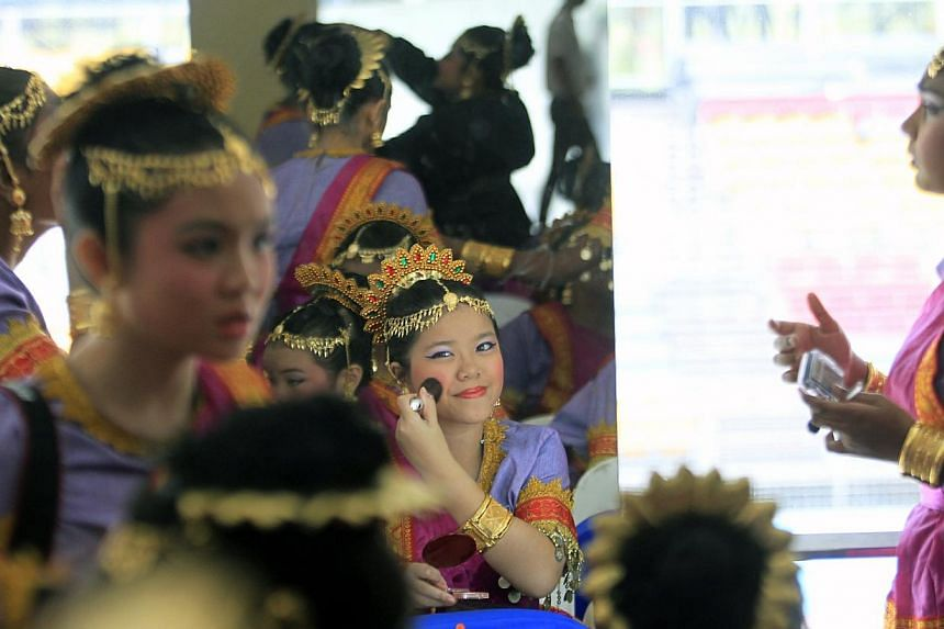Performers at the National Day Parade 2013 at the floating platform.--ST PHOTO: KEVIN LIM