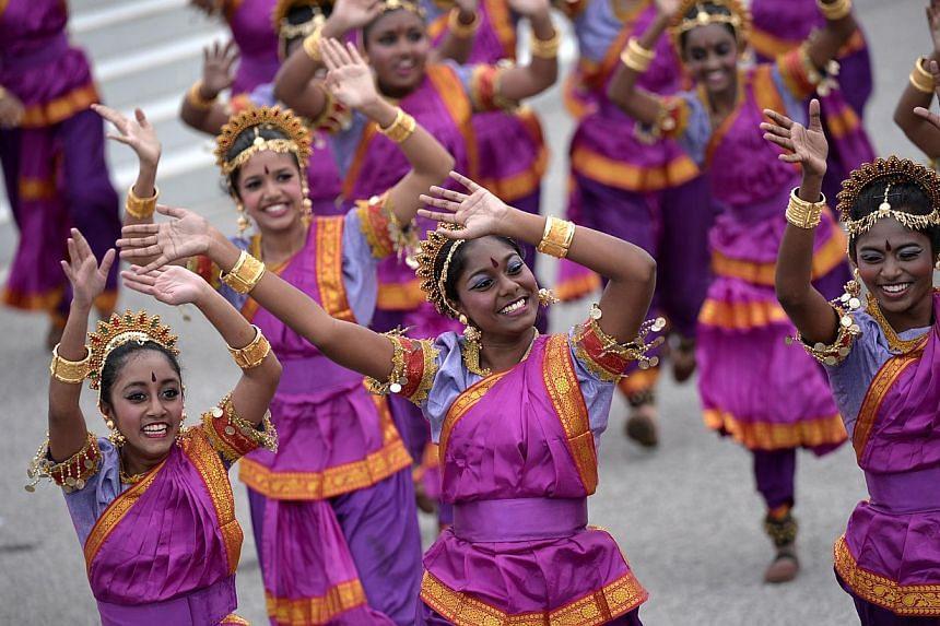 Performers dancing at the National Day Parade 2013 at the floating platform.--ST PHOTO:MUGILAN RAJASEGERAN