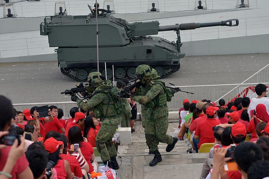 During the three-and-a-half hour National Day Parade on Friday, Aug 9, 2013, 26,000 spectators were treated to a display of defence hardware, aerial flypass, and a variety show with plenty of song and dance.--ST PHOTO:KUA CHEE SIONG