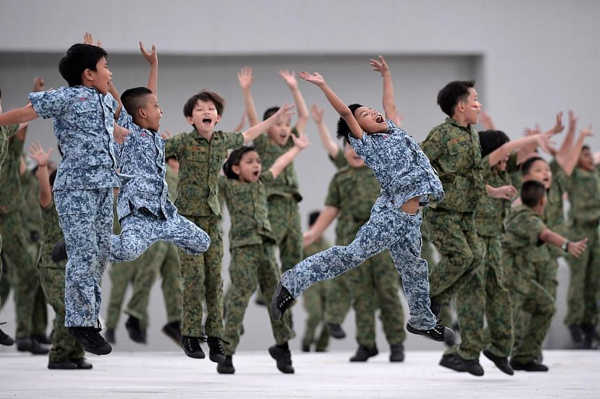 During the three-and-a-half hour National Day Parade on Friday, Aug 9, 2013, 26,000 spectators were treated to a display of defence hardware, aerial flypass, and a variety show with plenty of song and dance. -- ST PHOTO: MARK CHEONG