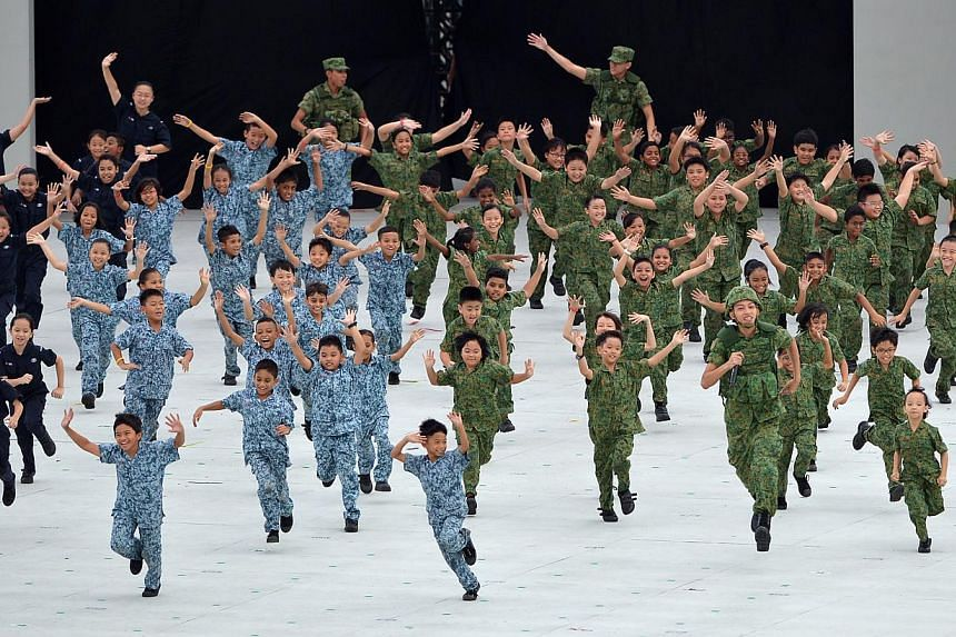 During the three-and-a-half hour National Day Parade on Friday, Aug 9, 2013, 26,000 spectators were treated to a display of defence hardware, aerial flypass, and a variety show with plenty of song and dance.--ST PHOTO:MUGILAN RAJASE