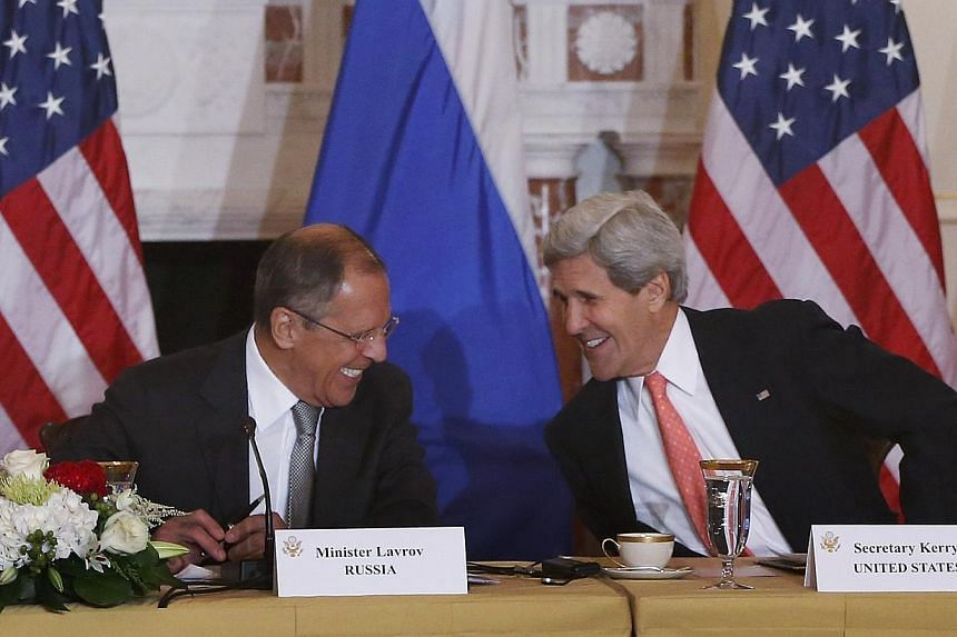 "Russian Foreign Minister Sergei Lavrov(left). US Secretary of State John Kerry (right) said on Friday that the United States still has ""shared interests"" with Russia despite a sharp chill in ties. -- PHOTO: AP"