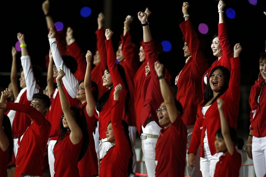 It may have been panned on forums and in the blogosphere, but this year's NDP theme song, One Singapore, received a much more favourable reception at the parade.Parade-goers stood up and sang their hearts out, no doubt egged on by the carnival