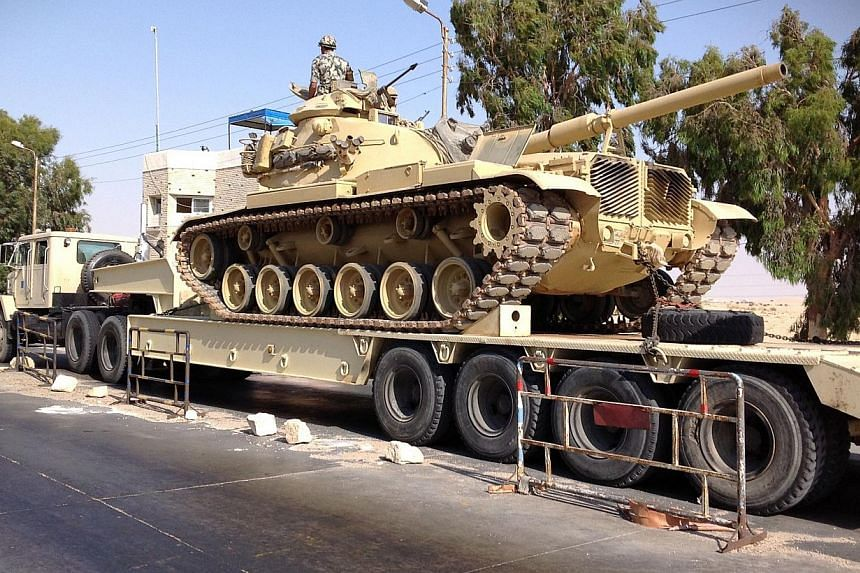 An Egyptian military tank is deployed in the northern Sinai town of Al-Arish on July 16, 2013.Four Islamist militants were killed by a missile strike in Egypt's North Sinai region on Aug 9, 2013, as they prepared to launch rockets at Israel, Eg