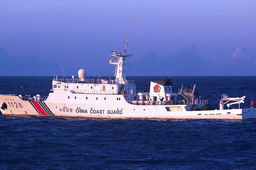This handout picture taken by the Japan Coast Guard on Aug 6, 2013, shows a Chinese Coast Guard ship cruising near the disputed islets known as the Senkaku islands in Japan and Diaoyu islands in China, in the East China Sea.Four Chinese governm