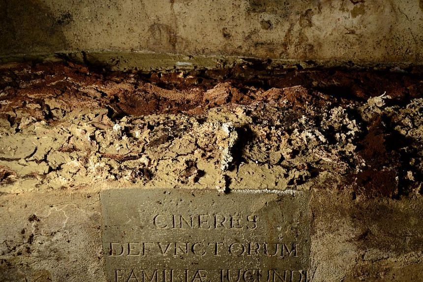 """A commemorative stone reading """"Ashes of the Giocondo family deceased"""" identifies the bones of Giocondo family members in their cript in Florence's Santissima Annunziata Basilica, on Aug 9, 2013.Researchers opened a centuries-old Florence tomb"""