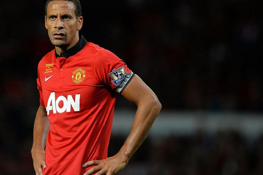 Manchester United's English defender Rio Ferdinand looks on during the pre-season friendly football match between Manchester United and Sevilla at Old Trafford in Manchester, north-west England, on Aug 9, 2013. The game is a testimonial match for Man