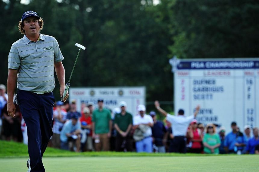 Jason Dufner of the United States walks across the 17th green during the second round of the 95th PGA Championship on Aug 9, 2013, in Rochester, New York. Dufner matched the low 18-hole score in major golf history on Friday, firing a seven-under par
