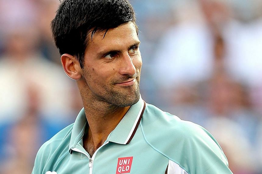 Novak Djokovic of Serbia celebrates match point against Richard Gasquet of France during the Rogers Cup at Uniprix Stadium on Aug 9, 2013 in Montreal, Quebec, Canada. Novak Djokovic delivered a crushing 6-1, 6-2 defeat to France's Richard Gasquet as