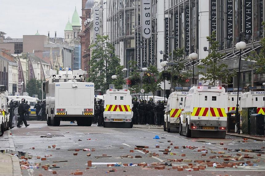 Bricks litter Royal Avenue after rioting in the centre of Belfast, Northern Ireland on Friday, Aug 9, 2013. Fifty-six police officers and two civilians were injured in protests in central Belfast, the authorities said on Saturday, Aug 10, 2013, follo