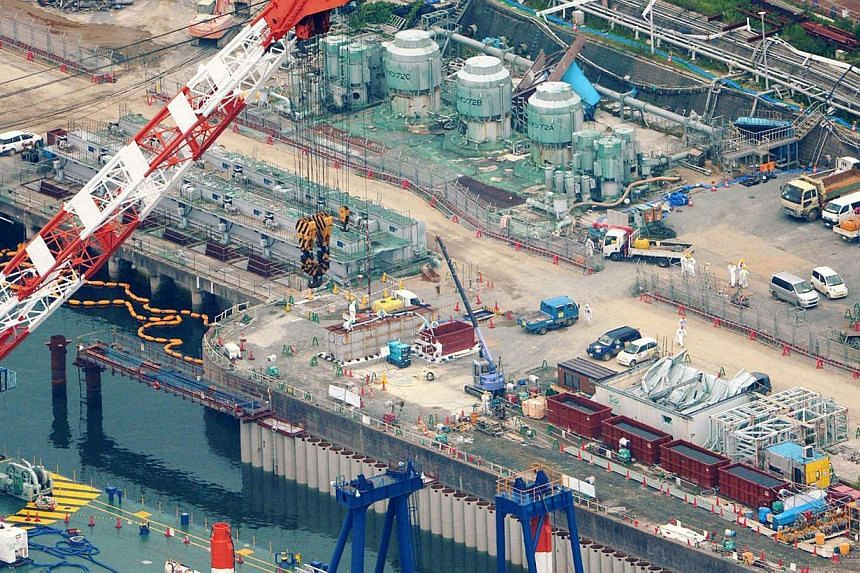 An aerial view shows a construction site of the shore barrier to stop radioactive water from leaking into the sea, at the tsunami-crippled Fukushima Daiichi nuclear power plant in Fukushima on Friday, Aug 9, 2013. The operator of the crippled Japanes