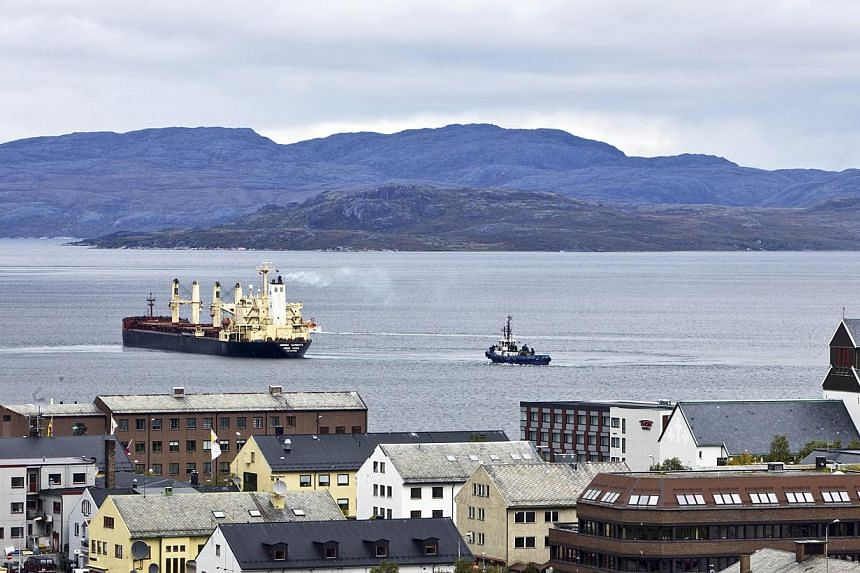 This photo taken on September 4, 2010 shows Hong Kong-flagged Nordic Barents carrying 40,000 tonnes of iron ore leaving Kirkenes in the north of Norway on route to China via the Arctic Northeast passage. Due to global warming ice is melting rapidly i