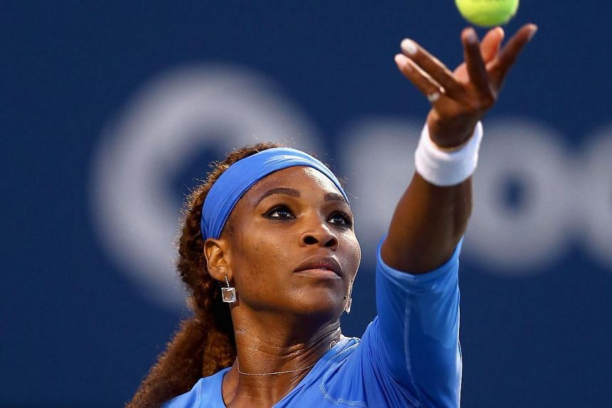 Serena Williams tosses the ball on her serve during her 7-6(3),6-4 win over Agnieszka Radwanska of Poland during the semifinals of the Rogers Cup Toronto at Rexall Centre at York University on Aug 10, 2013 in Toronto, Ontario, Canada.World numb