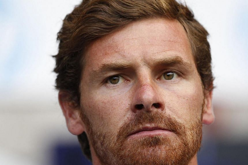 Tottenham Hotspur's Portuguese manager Andre Villas-Boas looks on before during the pre-season friendly football match between Tottenham Hotspur and Espanyol at White Hart Lane in north London on August 10, 2013. Tottenham manager Andre Villas-Boas h