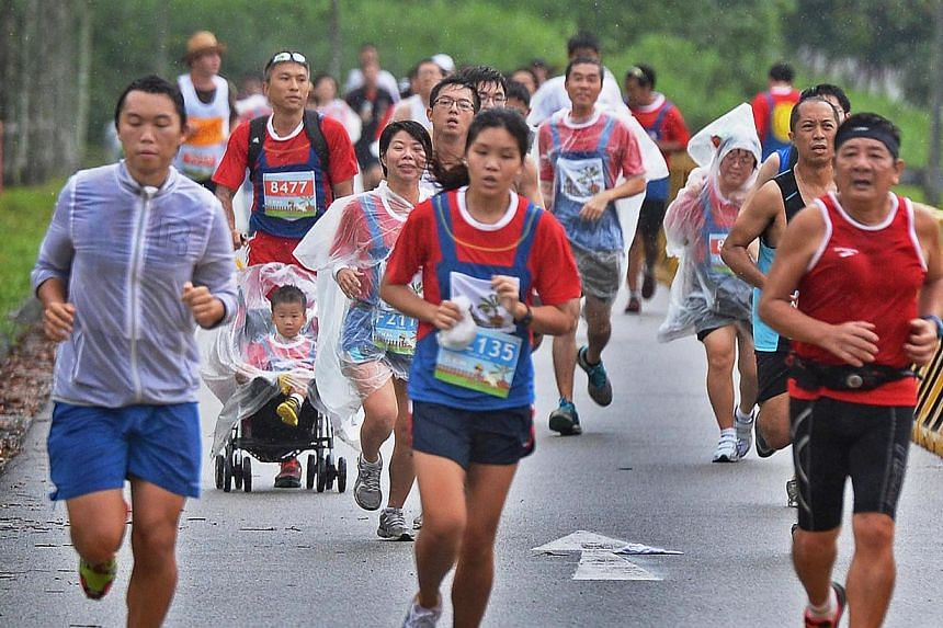 Participants taking part in the inaugural Kranji Countryside Run on Sunday,  Aug 11, 2013. Bad weather on Sunday morning affected two running events - the inaugural Kranji Countryside Run and the adidas King of the Road event. -- ST PHOTO:&