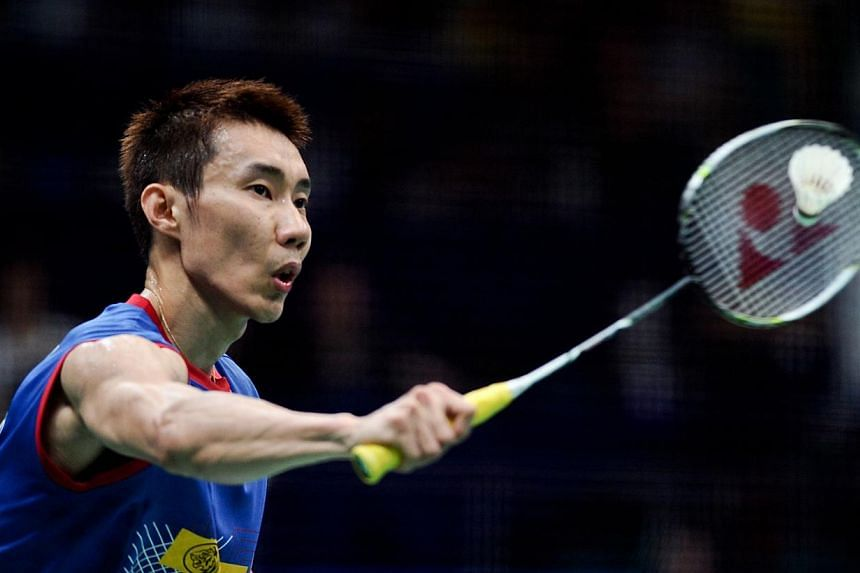 Malaysia's Lee Chong Wei returns to China's Du Pengyu during their men's singles semi-final at World Badminton Championships in Guangzhou, south China's Guangdong province on August 10, 2013. World number one Lee Chong Wei will face Chinese superstar
