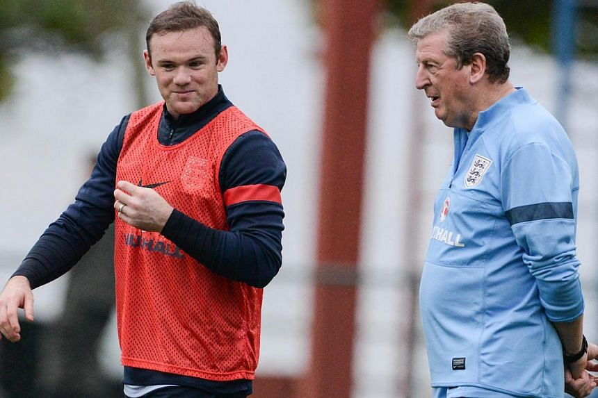 England's national football team player Wayne Rooney (L) speaks with coach Roy Hodgson during a training sesssion in Rio de Janeiro, Brazil, on May 31, 2013. England manager Roy Hodgson has dismissed concerns about the shortage of world-class striker