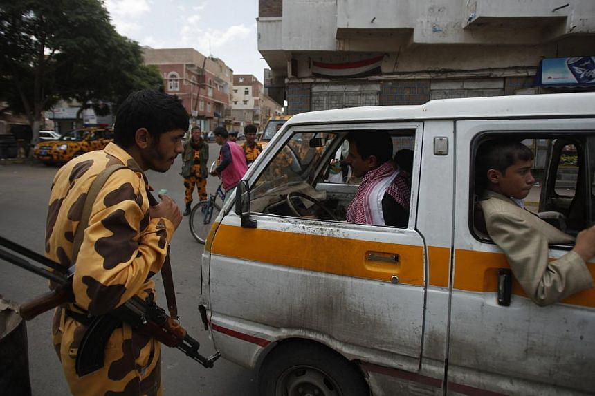 """A police trooper guards a checkpoint on a street in Sanaa on Aug 10, 2013. An attack by """"Al-Qaeda elements"""" at a gas export terminal in Yemen killed five soldiers on Sunday, Aug 11, 2013, a military source said, as Washington kept its embassy in Sana"""