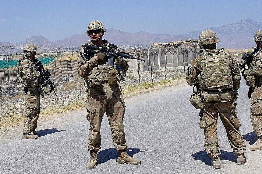 US soldiers, part of the Nato-led International Security Assistance Force (ISAF), standing guard on the outskirts of Laghman on June 5, 2013. The Afghan army and police have grown rapidly in a multi-billion international effort to build up the countr