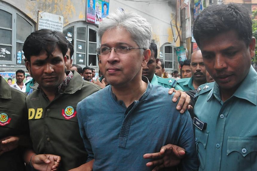 Human rights group Odhikars' secretary Adilur Rahman Khan (centre) being taken away by the police in Dhaka on August 11, 2013. A Dhaka court on Sunday granted police a 10-day remand to grill Mr Khan for allegedly distorting facts about the May 5 poli
