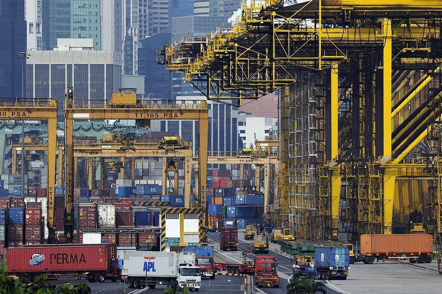 Shipping containers are moved and stacked at the port of Singapore, on Wednesday, Oct. 13, 2010.Singapore's exports continued to see further declines in the second quarter of this year. Non-oil domestic exports (NODX) fell 4.9 per cent compared