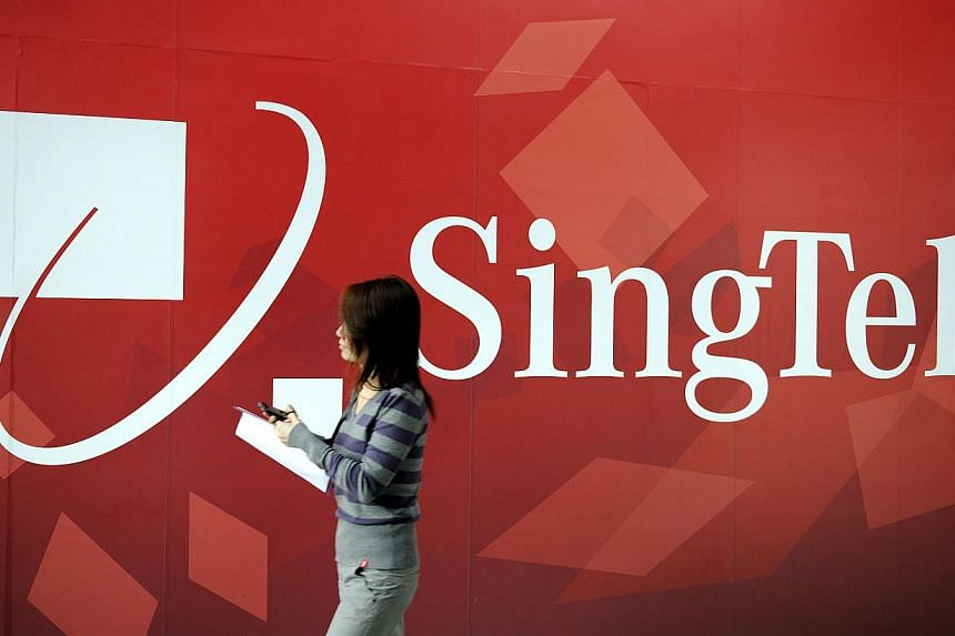 A pedestrian walks past a billboard advertisement for Singapore Telecommunications Ltd. (SingTel) in Singapore, on Monday, March 14, 2011. SingTel mobile customers on Android devices and do not have a credit card will be able to pay for apps on Googl