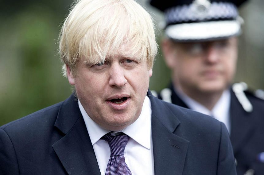 """Mayor of London Boris Johnson arrives at a police cordon in Woolwich, London on May 23, 2013, at the site of the murder of a soldier by two suspected Islamists. Mr Johnson on Monday issued a """"hands off"""" warning to Spain over Gibraltar after Madrid vo"""