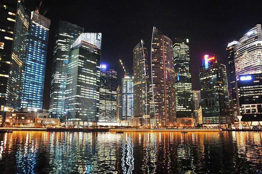 The Singapore Central Business District (CBD) skyline by night on Sept 22, 2011, showing the skyscrapers which house offices and banks on the edge of the Marina Bay. The Singapore economy expanded by 3.8 per cent in the second quarter from the s