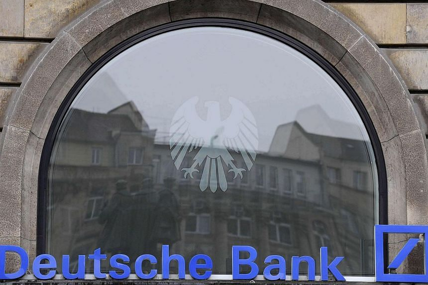File photo of logo of Germany's largest business bank Deutsche Bank AG in Frankfurt October 31, 2008.Deutsche Bank has named Mr Michael Ormaechea and Mr Bhupinder Singh as co-heads for its corporate banking and securities unit for the Asia Paci