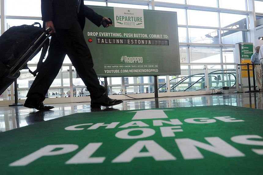 Heineken challenges JFK travelers to drop their plans for new legendary destinations with Departure Roulette at JFK Airport, Tuesday, July 9, 2013.Two customs inspectors at New York's John F. Kennedy airport fell ill Sunday after handling a par