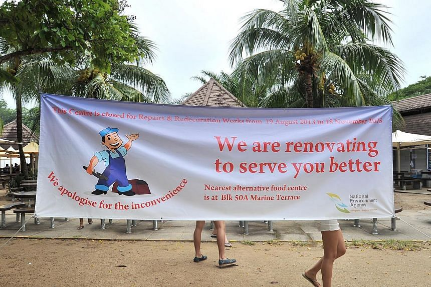 The renovation notice at East Coast Lagoon Food Village on Aug 11 2013.  -- PHOTOS: LIM YAOHUI FOR THE STRAITS TIMES