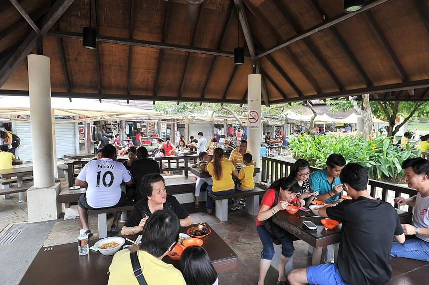 Patrons having lunch at East Coast Lagoon Food Village on Aug 11 2013.-- PHOTOS: LIM YAOHUI FOR THE STRAITS TIMES